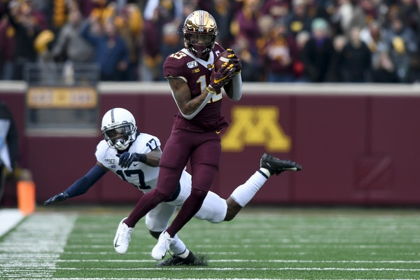 Gophers wide receiver Rashod Bateman caught a touchdown pass in the first quarter as Penn State safety Garrett Taylor missed the tackle.