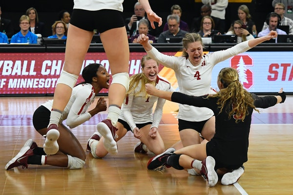 Stanford celebrated after defeating Nebraska 3-2 in the NCAA Division 1 Volleyball Championship match on Saturday, Dec. 15, 2018 at Target Center in M