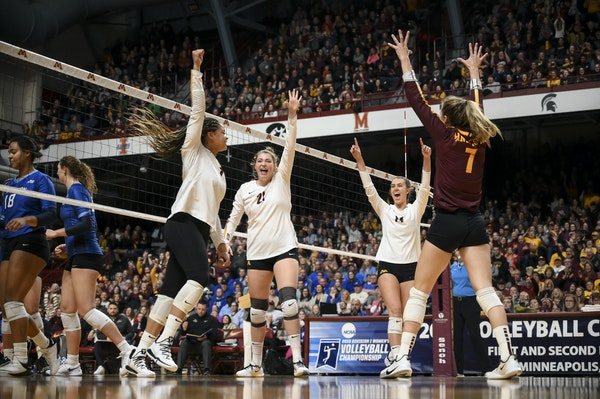 Gophers players, from left, outside hitter Alexis Hart (19), middle blocker Regan Pittman (21), setter Kylie Miller (14) and libero CC McGraw (7) cele
