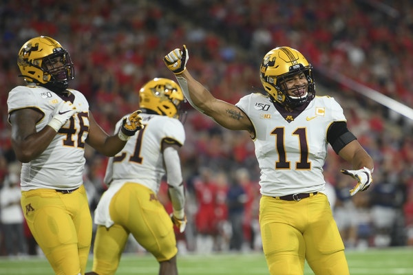 Gophers safety Antoine Winfield Jr. (11) celebrated after forcing a fourth down in Saturday's 38-35, double-overtime victory over Fresno State.