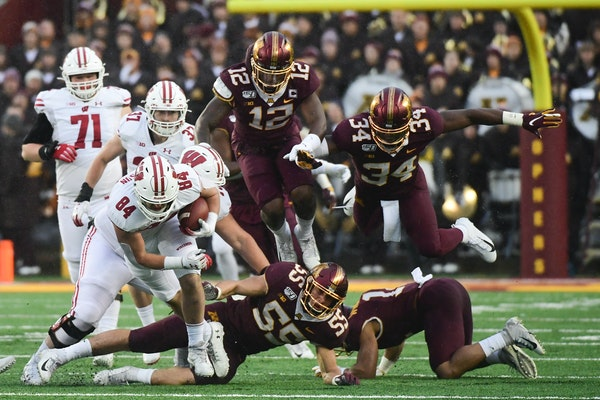 After Wisconsin beat Minnesota 38-17 on Saturday, the Badgers jumped up four spots in the College Football Playoff rankings to No. 8 and the Gophers f
