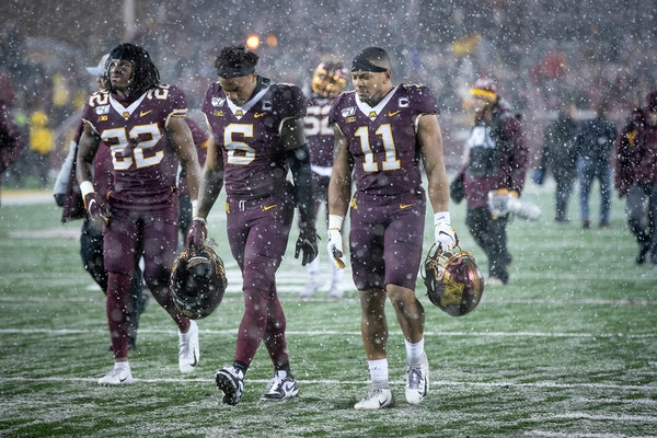 Dejected Gophers players walked off the field after Minnesota's 38-17 loss to Wisconsin in the Battle for Paul Bunyan's Axe at TCF Bank Stadium on Sat
