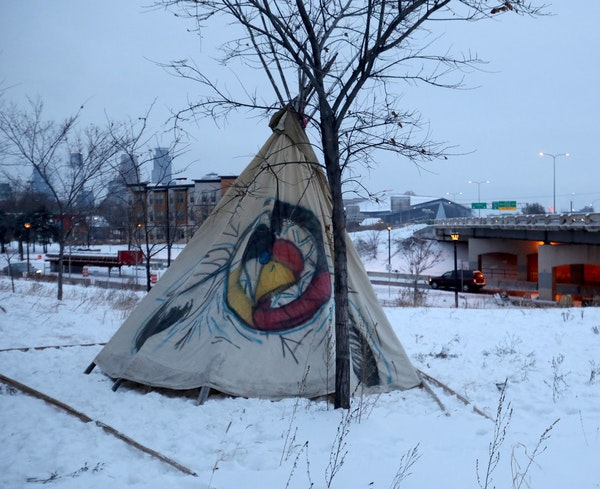 Protesters have erected a teepee at the center of a former homeless encampment in south Minneapolis, seen Saturday morning.