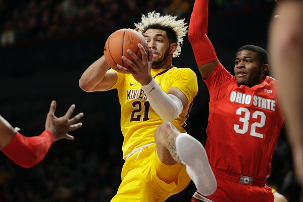 Gopehrs forward Jarvis Omersa grabs a rebound in front of Ohio State guard E.J. Liddell in the first half