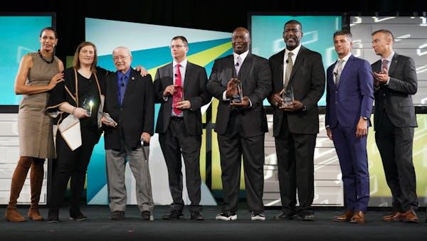 (From left) Host Lea B. Olson, Lindsay Whalen, Willard Ikola, Jim Gagliardi, John Randle, Randall McDaniel, host Anthony LaPanta and Star Tribune spor