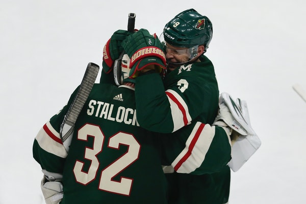 Wild center Mikko Koivu hugged goalie Alex Stalock after Stalock blocked a shot in a shootout to beat the the Dallas Stars 3-2 on Sunday at Xcel Energ