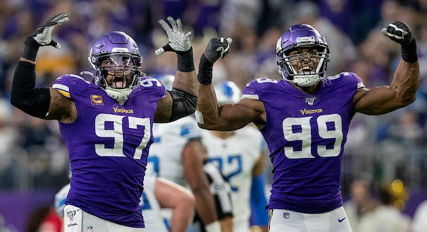 Minnesota Vikings' Everson Griffen (97) and Danielle Hunter (99) celebrated after Hunter sacked Lions quarterback David Blough