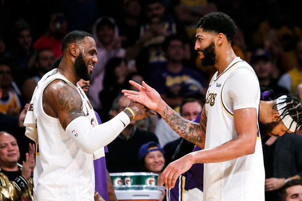 LeBron James, left, celebrates with teammate Anthony Davis during a timeout in the second hal.