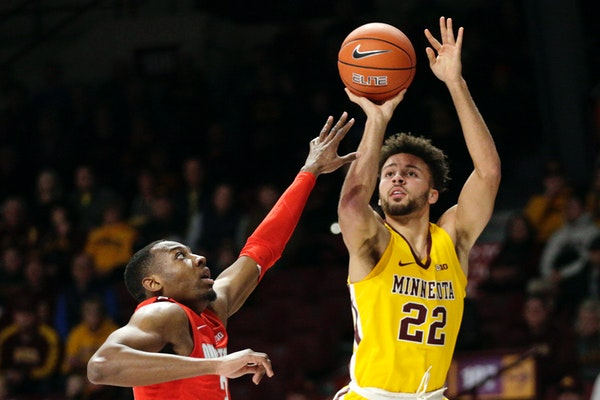 Gophers guard Gabe Kalscheur shot over Ohio State guard D.J. Carton in the first half of the Gophers' 84-71 upset of the No. 3 Buckeyes on Sunday.