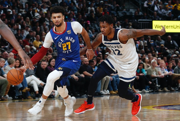 Denver guard Jamal Murray drove past Wolves defender Treveon Graham during the second half Friday.