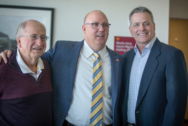 Upon his hiring as Gophers men's hockey coach in 2018, Bob Motzko was flanked by Doug Woog, left, the coach from 1985-99, and Don Lucia, the coach fro