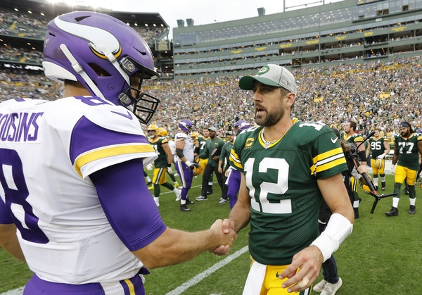 Green Bay Packers' Aaron Rodgers talks to Minnesota Vikings' Kirk Cousins after an NFL football game Sunday, Sept. 15, 2019, in Green Bay, Wis. The Pa