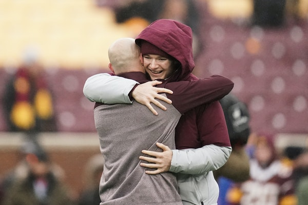 Gophers holder Casey O'Brien and Gophers football coach P.J. Fleck embraced before the Wisconsin game. O'Brien, who had undergone surgery only a few d