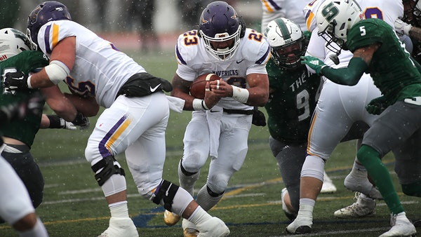 Minnesota State Mankato running back Nate Gunn charged into the line Saturday, when he scored three touchdowns in the Mavericks' victory over Slippe