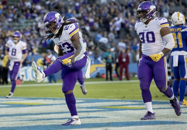 Vikings running back Mike Boone (23) celebrated after scoring his second touchdown on the fourth quarter on Sunday.