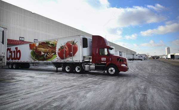 File photo of trailers lined up at the loading docks at the UNFI distribution center in Hopkins. Workers went on strike at the site Tuesday.