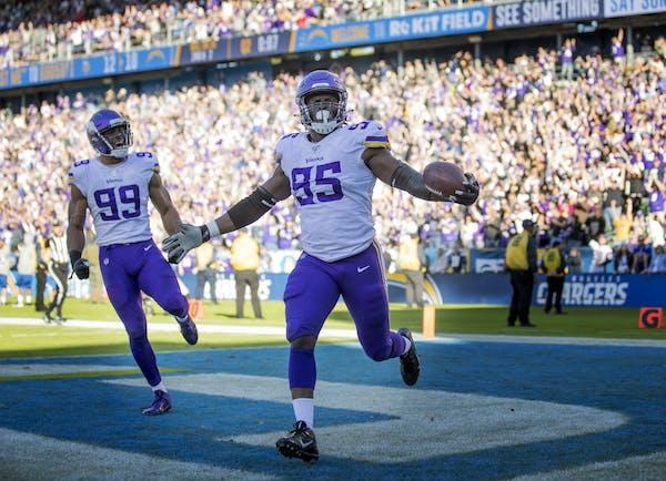 Vikings defensive end Ifeadi Odenigbo (95) celebrated his 56 yard fumble recovery touchdown run .