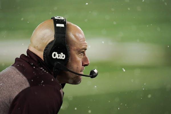 Coaches pick Fleck as coach of the year; media chooses Buckeyes coach