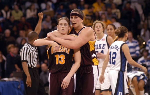 Janel McCarville hugs Lindsay Whalen near the end of the Gophers' Elite Eight victory over Duke in Norfolk, Va., in March 2004, earning the program a