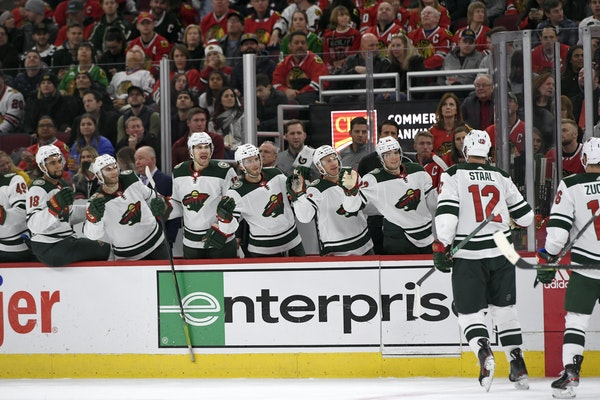 Eric Staal celebrated with the Wild bench after his 1,000th NHL point, a goal in Chicago on Sunday.