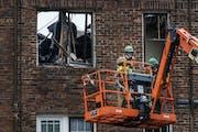 Careful demolition of the Francis Drake Hotel has begun in Minneapolis. Crew members used hazmat masks because of residue toxic fumes.