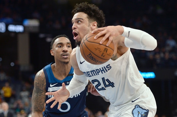 Grizzlies guard Dillon Brooks, who scored a game-high 28 points, drove past Timberwolves guard Jeff Teague during the second half Tuesday.