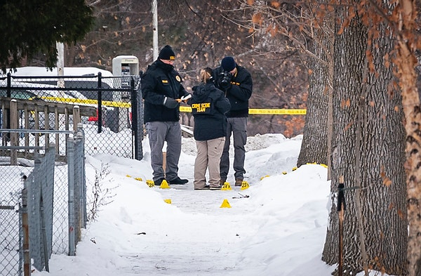 Investigators on the scene of a shooting where a man was shot and critically wounded by Minneapolis police responding to a domestic-related assault on