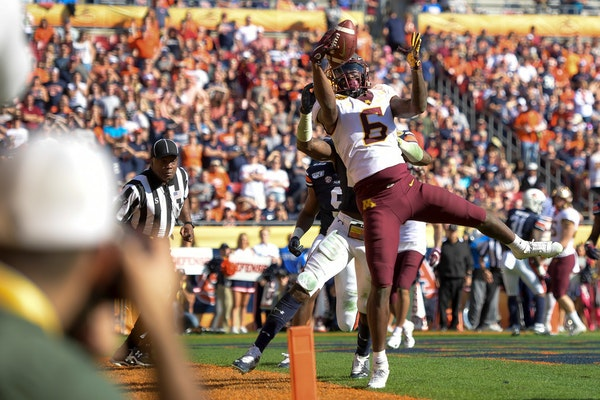 Gophers wide receiver Tyler Johnson's hands and feet were in perfect unison on an acrobatic 2-yard touchdown grab late in the first half of Wednesda