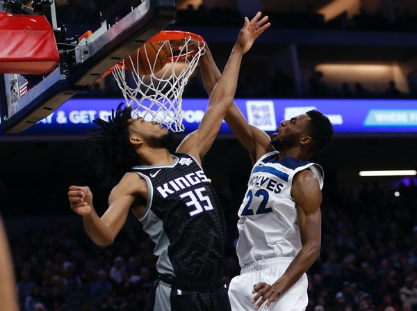 Wolves forward Andrew Wiggins duned over Kings forward Marvin Bagley III during the first quarter Thursday,