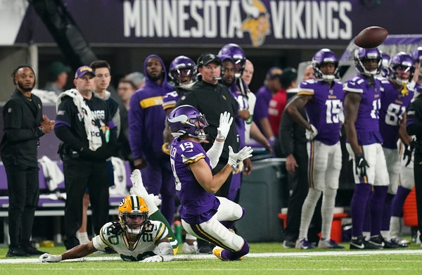 Vikings receiver Adam Thielen couldn't come up with a catch on a long pass from Kirk Cousins against Green Bay on Monday.