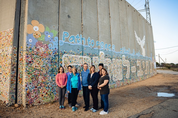"""Minnesota legislators standing in front of the """"Path to Peace"""" mosaic within an Israeli agricultural community near the Gaza border."""