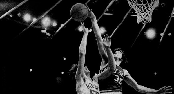 Little Falls center Frank Wachlarowicz, shown blocking a shot by Robbinsdale's Tom Fix in the 1975 Class AA title game, is one of 15 new Minnesota H