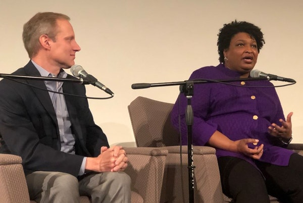 Democrat Stacey Abrams talked about voter suppression with Minnesota Secretary of State Steve Simon during a panel discussion on voting rights Saturda