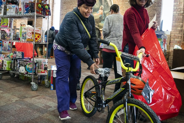 Thwanda Thomas of Minneapolis picked out a bike for her 7-year-old at the Salvation Army Toy Shop on Wednesday, Dec. 18.