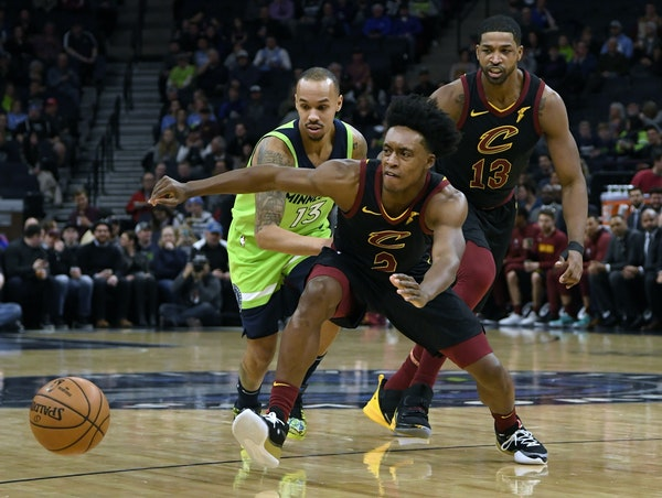Minnesota Timberwolves' Shabazz Napier (13) and Cleveland Cavaliers' Collin Sexton (2) go after a loose ball as Cleveland Cavaliers' Tristan Tho