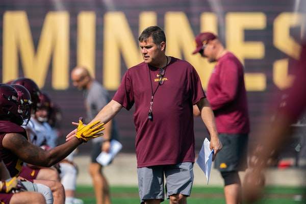 Gophers offensive coordinator Kirk Ciarrocca ran players through drills during practice Friday. Ciarrocca is back for his third season after declining