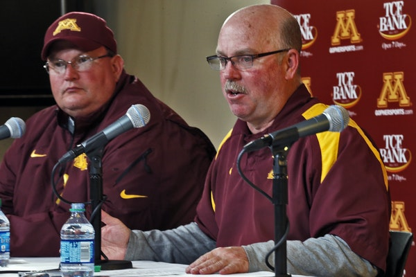 Tracy Claeys, left, sat at a news conference with Gophers coach Jerry Kill in November 2013.