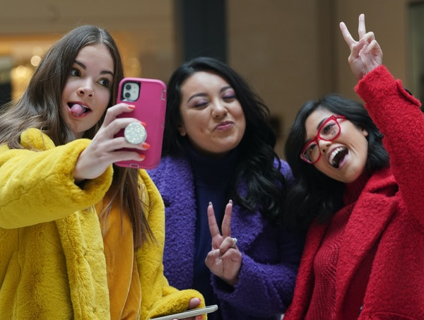 Influencers Eva Igo, Andrea Peña and Cindi Yang posed for a selfie during a photo shoot for the Rosedale holiday campaign.