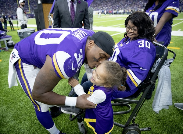 Vikings fullback C.J. Ham's honored his mother during halftime against the Lions on Dec. 8 at U.S. Bank Stadium. He gave daughter Skylar, 3, a kiss.