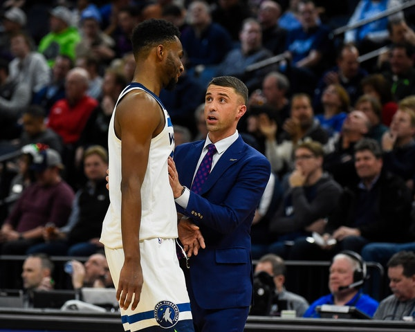Ryan Saunders and Andrew Wiggins talked during the second half on Wednesday night.