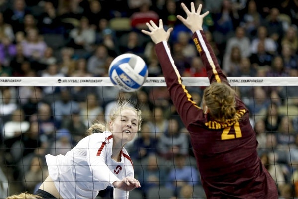 Stanford's Kathryn Plummer drove a spike past the Gophers' Regan Pittman (21) for a point Thursday night.