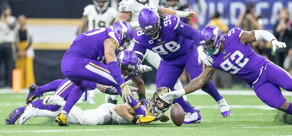 Vikings defensive end Danielle Hunter (second from left) sacked Saints quarterback Drew Brees to force a fumble in the fourth quarter. The Vikings' de