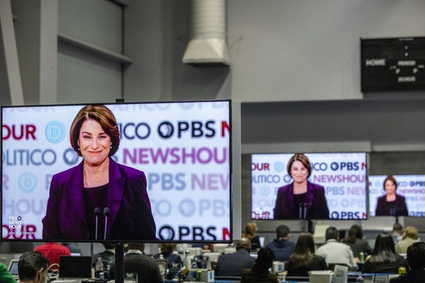 Screens show Sen. Amy Klobuchar (D-Minn.) during the Democratic presidential debate co-hosted by PBS and Politico at Loyola Marymount University in Lo