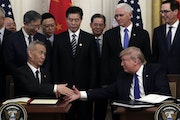 President Donald Trump shakes hands with Chinese Vice Premier Liu He, after signing a trade agreement in the East Room of the White House Wednesday.