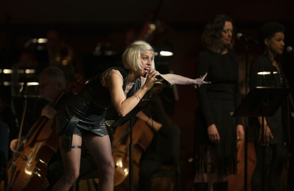 Dessa performing with the Minnesota Orchestra.