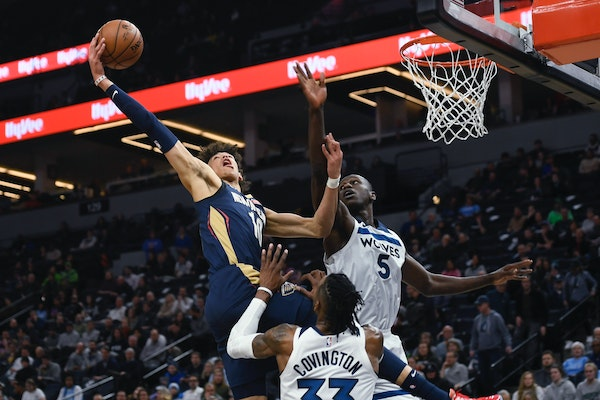 New Orleans center Jaxson Hayes went up for a dunk against Wolves center Gorgui Dieng (5) and over forward Robert Covingtonduring the second half We