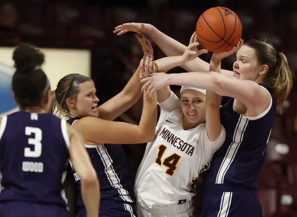 Gophers Sara Scalia (14) ran into the defense of Wildcats Abi Scheid (44) and Abbie Wolf (21).