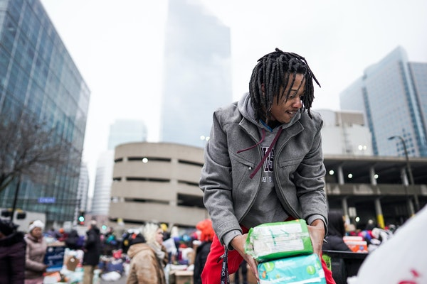 Volunteer Robert Hill of Minneapolis helped load donations onto trucks Wednesday as displaced Francis Drake residents were bused to temporary shelters