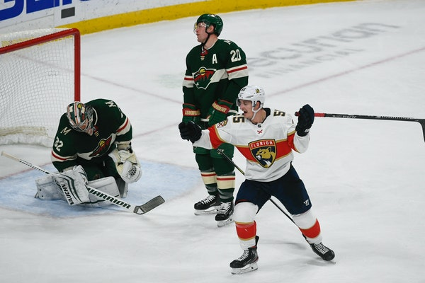Panthers right winger Noel Acciari, right, celebrated in front of disappointed Wild defenseman Ryan Suter (20) and goalie Alex Stalock after Acciari t