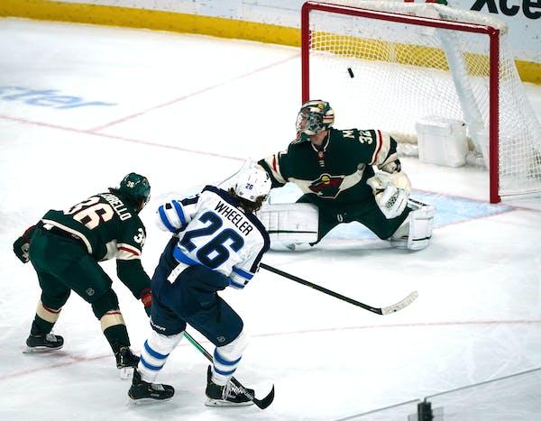 Winnipeg right wing Blake Wheeler got a shot past Wild goaltender Alex Stalock in the first period.